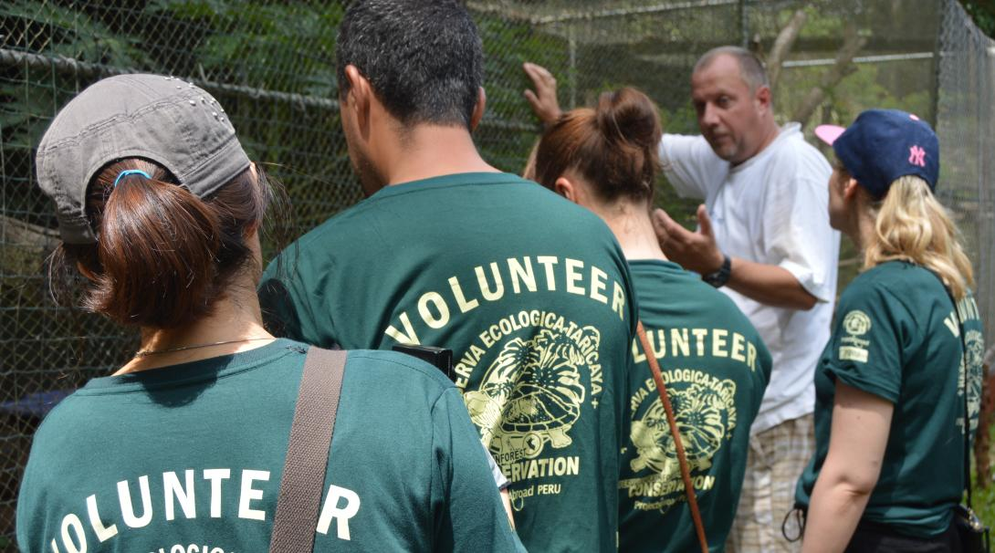 Projects Abroad Conservation Director tells the volunteers about the animals at the rescue centre in Peru